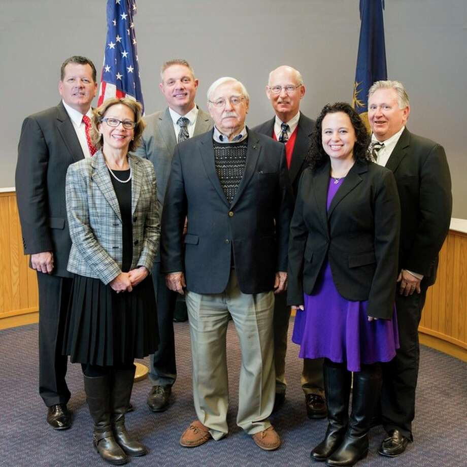 The 2017-2018 Midland County Board of Commissioners, front row, from left: Gaye Terwillegar, R-4th District, Vice Chairman Jim Geisler, R-5th District, and Jeanette Snyder R-1st District. Back row, Eric Dorrien, R-6th District, Chairman Mark Bone, R-2nd District, Steve Glaser, R-3rd District, and Scott Noesen, R-7th District.