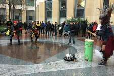 A small, boisterous crowd that included Native American dancers and drummers gathered outside the Ronald Dellums Federal Building in Oakland Friday morning to protest the inauguration of President-elect Donald Trump.