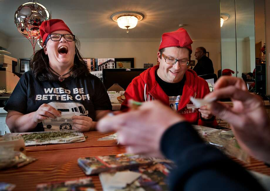 Elizabeth Croydon and Adam Eidinger with The DC Cannabis Campaign group (a.k.a. DCMJ) roll marijuana joints ahead of a pot handout during the inauguration of President-elect Donald Trump in Washington, D.C. Photo: The Washington Post, Getty Images