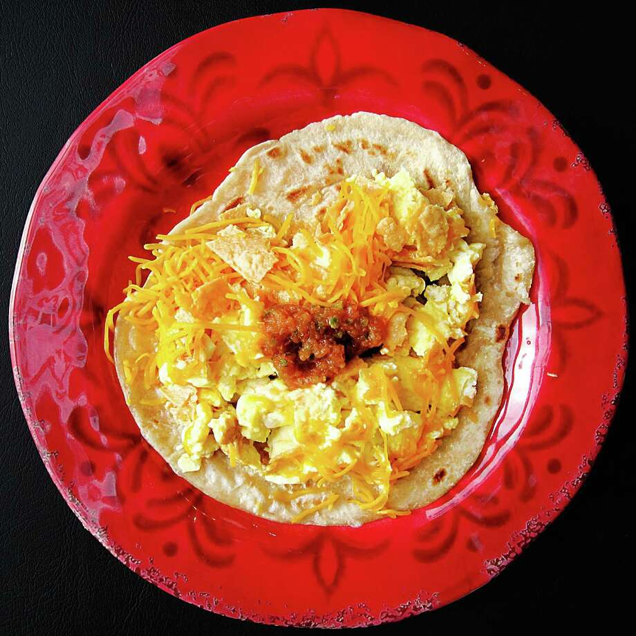 A migas taco on a handmade flour tortilla from Tacos Ricos. Photo: Mike Sutter /San Antonio Express-News