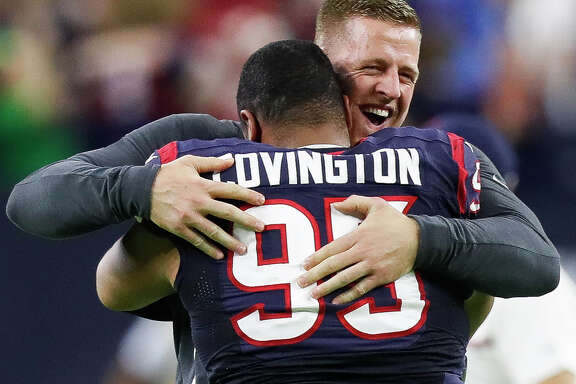 JJ Watt hugs Houston Texans defensive end Christian Covington (95) after Cincinnati Bengals kicker Randy Bullock (4) missed a field goal during the fourth quarter of an NFL football game at NRG Stadium, Saturday,Dec. 24, 2016 in Houston.  ( Karen Warren / Houston Chronicle )