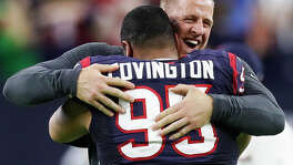 Injuries forced J.J. Watt to spend game days on the sideline cheering on teammates like Christian Covington. Watt hopes to be back on the field next year.
