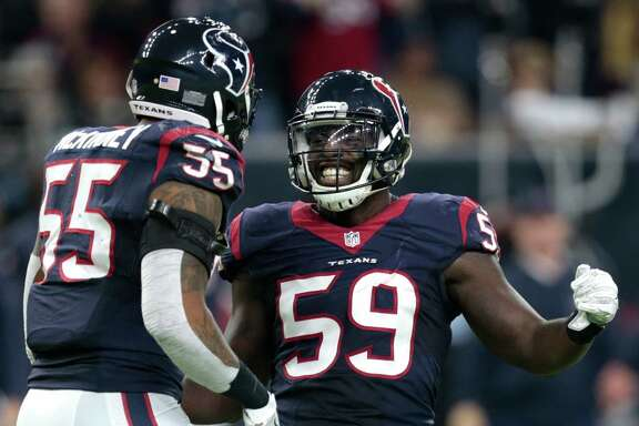 Houston Texans outside linebackers Whitney Mercilus (59) and Benardrick McKinney (55) celebrate Mercilus' sack of Oakland Raiders quarterback Connor Cook during the third quarter of an AFC Wild Card Playoff game at NRG Stadium on Saturday, Jan. 7, 2017, in Houston. ( Brett Coomer / Houston Chronicle )
