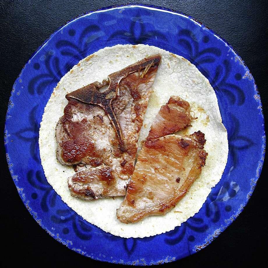 A pork chop taco on a handmade corn tortilla from Thousand Oaks Cafe. Photo: Mike Sutter /San Antonio Express-News