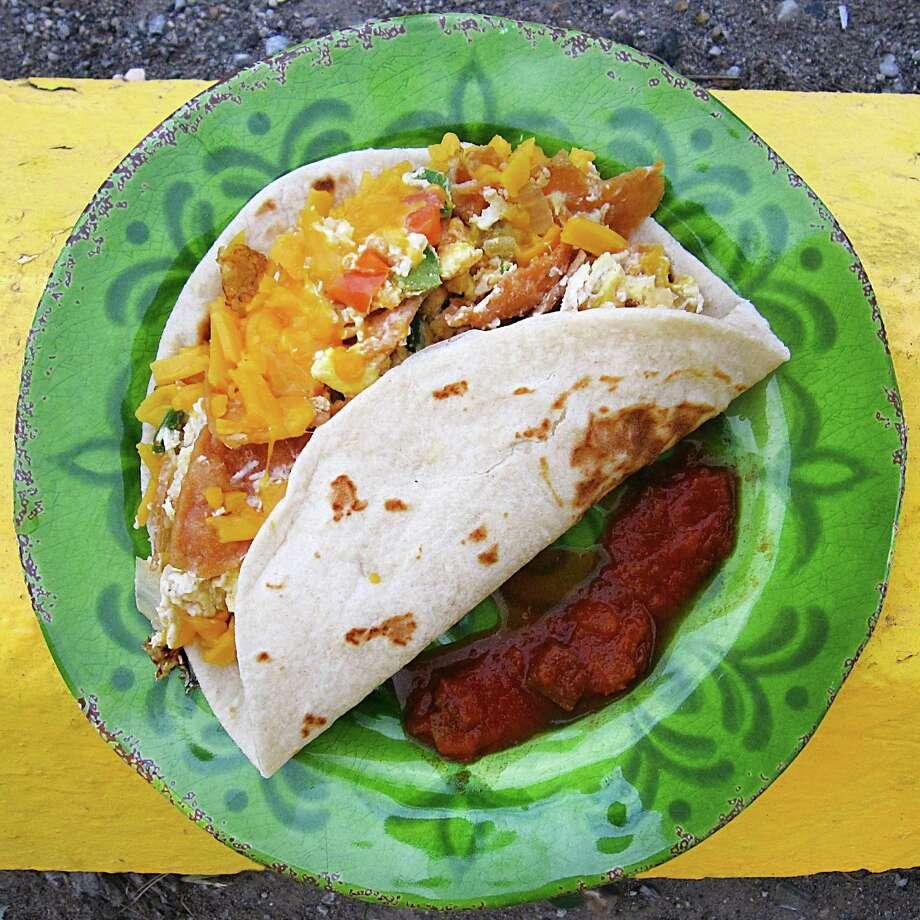 Chilaquiles taco on a handmade flour tortilla from Sarita's Mexican Restaurant. Photo: Mike Sutter /San Antonio Express-News