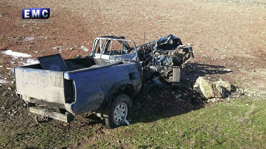This photo released on Wednesday, Jan. 11, 2017 by the Edlib Media Center, an opposition activist media collective, which has been authenticated based on its contents and other AP reporting, shows a vehicle that was hit an a aerial attack in the northwestern Syrian province of Idlib. Since Jan. 1, a wave of airstrikes have killed nearly three-dozen members of Fatah al-Sham Front and commanders of groups allied with the international terror network. The U.S. is targeting senior commanders of al-Qaida's affiliate in Syria at an unprecedented rate in northern Syria, killing nearly three dozen members of the group and militants allied with the international terror network since the beginning of the year. BC-Syria-Targeting al-Qaida. (Edlib Media Center via AP) Photo: Uncredited, HONS / Associated Press / Edlib Media Center