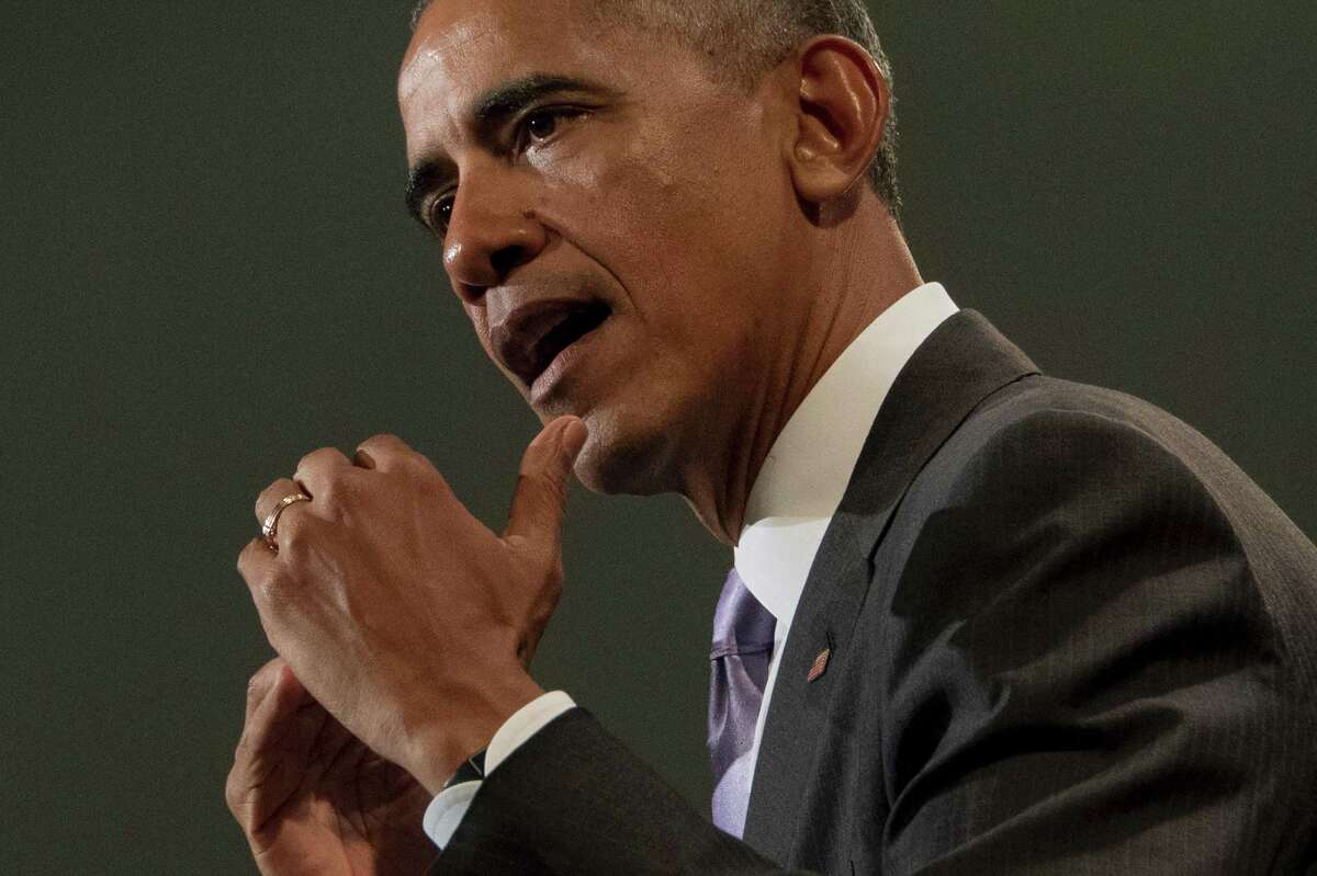"""(FILES) This file photo taken on October 20, 2016 shows US President Barack Obama delivering remarks on the Affordable Care Act at Miami Dade College in Miami, Florida. US President Barack Obama says he does not regret his speech drawing a """"red line"""" over Syria's use of chemical weapons, a phrase critics say symbolizes the US failure to act over the country's conflict. Obama made the comment in 2012 about possible US military action in Syria, saying """"a red line for us is we start seeing a whole bunch of chemical weapons moving around or being utilized."""" In what was billed as his last network interview, on CBS News program """"60 Minutes"""" broadcast on January 15, 2017 -- less than a week before his term ends Friday -- Obama confirmed that he had ad-libbed the phrase, which wasn't in the text of his speech. / AFP PHOTO / JIM WATSONJIM WATSON/AFP/Getty Images"""