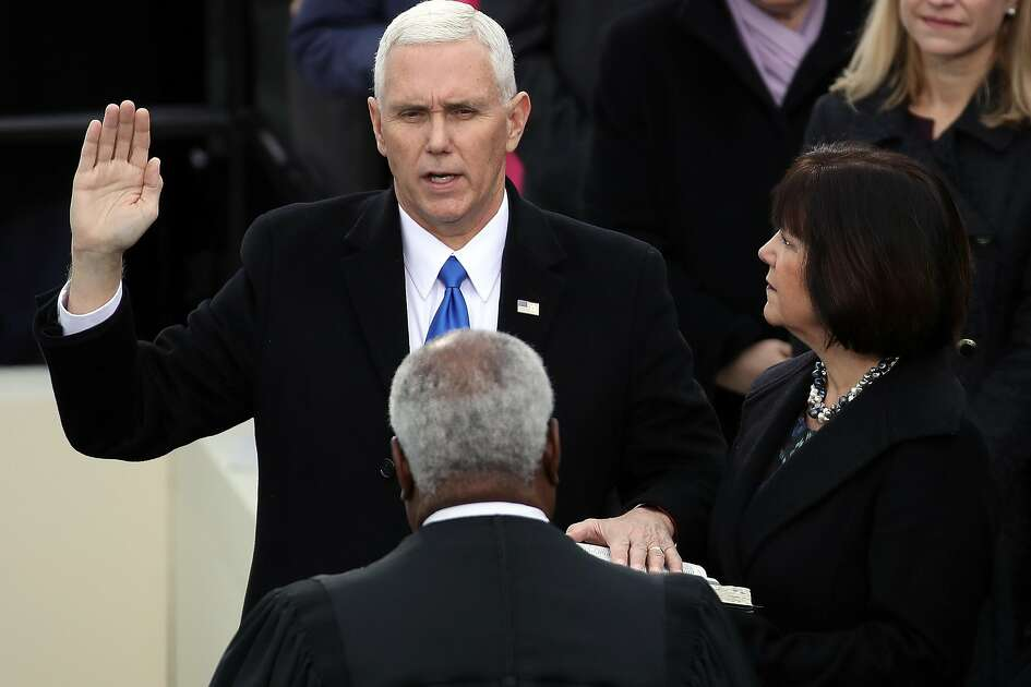 WASHINGTON, DC - JANUARY 20:  U.S. Vice President Mike Pence takes the oath of office from Supreme Court Justice Clarence Thomas as his wife Karen Pence looks on, on the West Front of the U.S. Capitol on January 20, 2017 in Washington, DC. In today's inauguration ceremony Donald J. Trump becomes the 45th president of the United States.  (Photo by Drew Angerer/Getty Images)