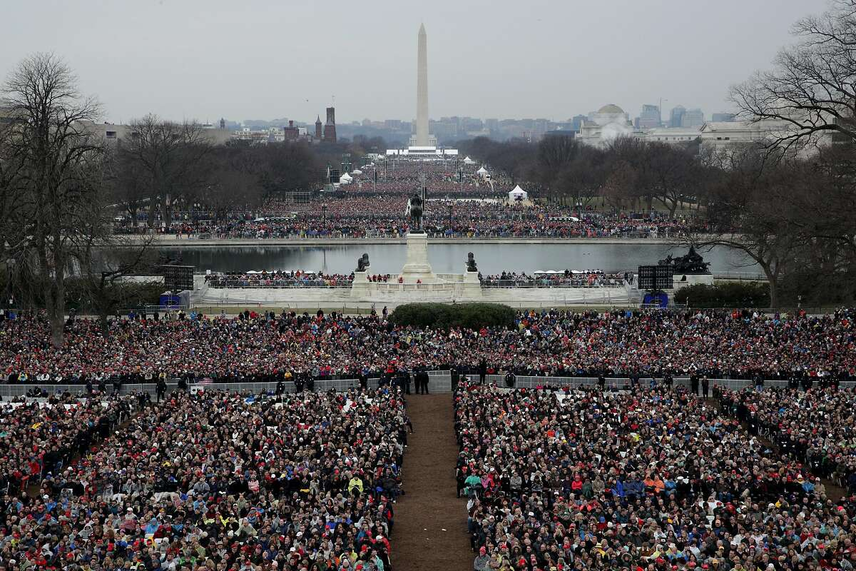2017:  Spectators fill the National Mall in front of the U.S. Capitol on January 20, 2017 in Washington, DC as Donald J. Trump becomes the 45th president of the United States. (Photo by Alex Wong/Getty Images)