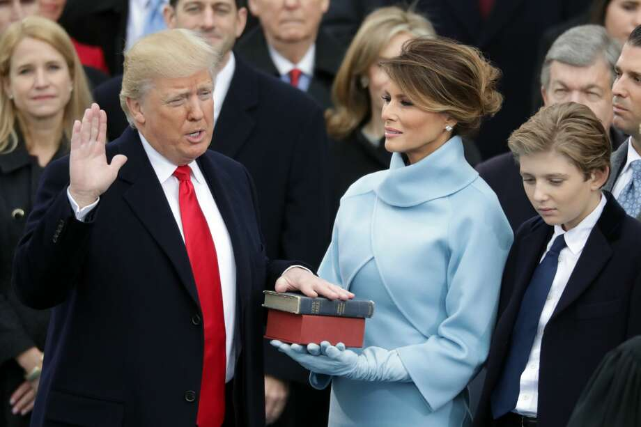 U.S. President Donald Trump takes the oath of office as his wife Melania Trump holds the bible and his son Barron Trump looks on, on the West Front of the U.S. Capitol on January 20, 2017 in Washington, DC. In today's inauguration ceremony Donald J. Trump becomes the 45th president of the United States.  (Photo by Chip Somodevilla/Getty Images) Photo: Chip Somodevilla/Getty Images