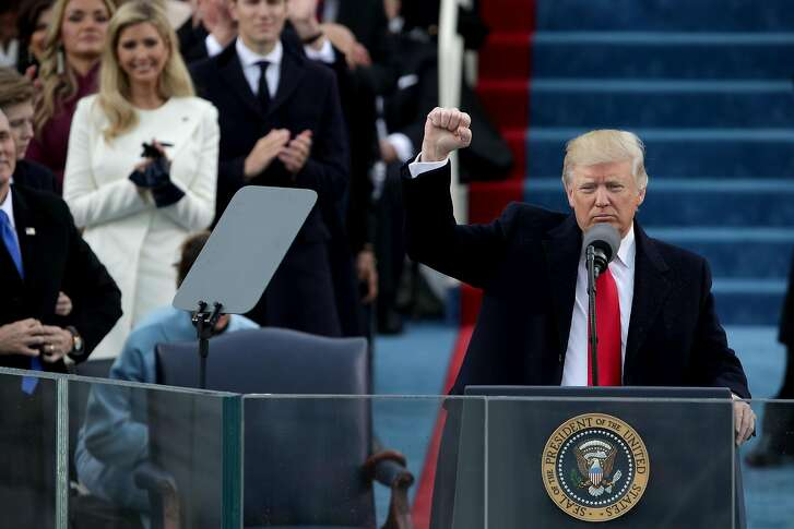 WASHINGTON, DC - JANUARY 20:  President Donald Trump raises a fist after his inauguration on the West Front of the U.S. Capitol on January 20, 2017 in Washington, DC. In today's inauguration ceremony Donald J. Trump becomes the 45th president of the United States.  (Photo by Alex Wong/Getty Images)