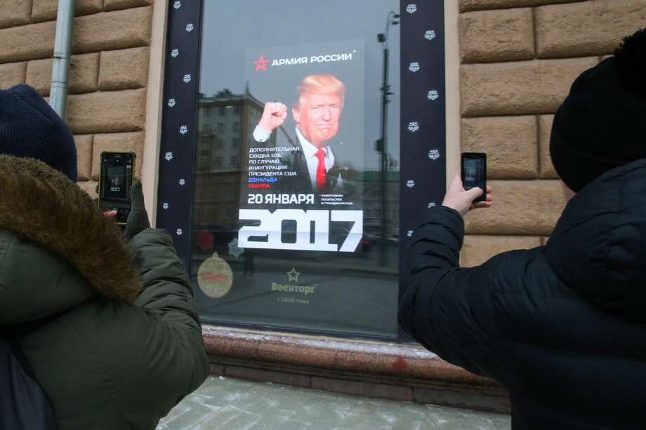 A 10% discount is offered to US citizens and US Embassy employees at an Army of Russia store on January 20, 2017, US President-elect Donald Trump's inauguration. The store is located across from the US Embassy in Moscow's Novinsky Boulevard. Vladimir Gerdo/TASS (Photo by Vladimir Gerdo\TASS via Getty Images) Photo: Vladimir Gerdo/Vladimir Gerdo/TASS