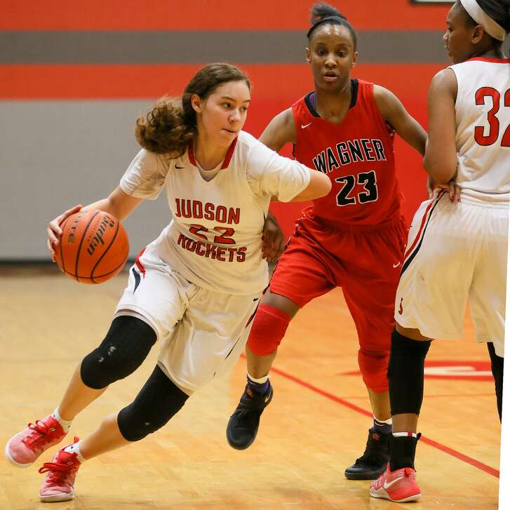 Judson's Kyra White (left) drives past Wagner's Kiana Williams as Desiree Lewis (32) sets a pick during the first half of their District 27-6A girls game at Judson on Jan. 10, 2017.