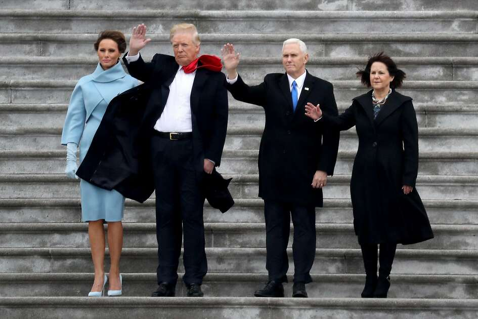 US First Lady Melania Trump, President Donald Trump, Vice President Mike Pence and Karen Pence wave goodbye to Barack and Michelle Obama on the West Front of the US Capitol on January 20, 2017 in Washington, DC. Donald Trump was sworn in as the 45th president of the United States Friday -- ushering in a new political era that has been cheered and feared in equal measure. / AFP PHOTO / POOL AND GETTY IMAGES NORTH AMERICA / Rob CarrROB CARR/AFP/Getty Images
