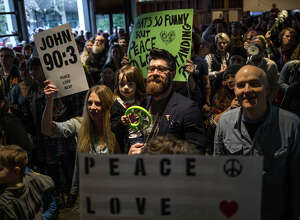 "The packed crowd sings along to ""Give Peace a Chance"" during KEXP's bed in for peace, inspired by Yoko Ono and John Lennon's 1969 bed in, on the day of the inauguration of President Donald Trump, Friday, Jan. 20, 2017."
