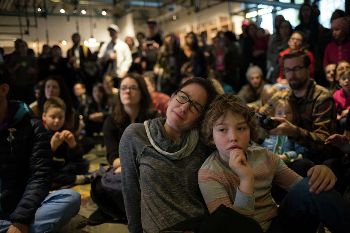 The crowd listens to local music during KEXP's bed in for peace, inspired by Yoko Ono and John Lennon's 1969 bed in, on the day of the inauguration of President Donald Trump, Friday, Jan. 20, 2017.