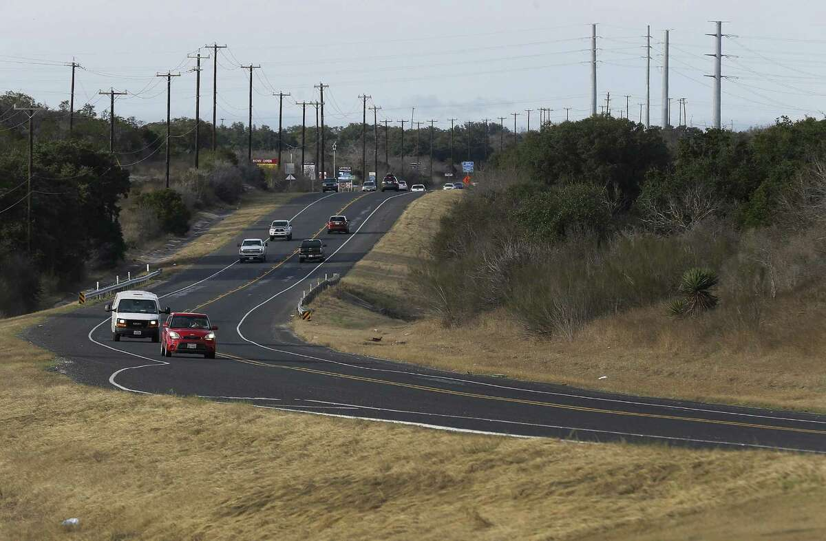 Traffic along Texas 211 is relatively light during the 5 p.m. rush hour compared to areas of the North Side.