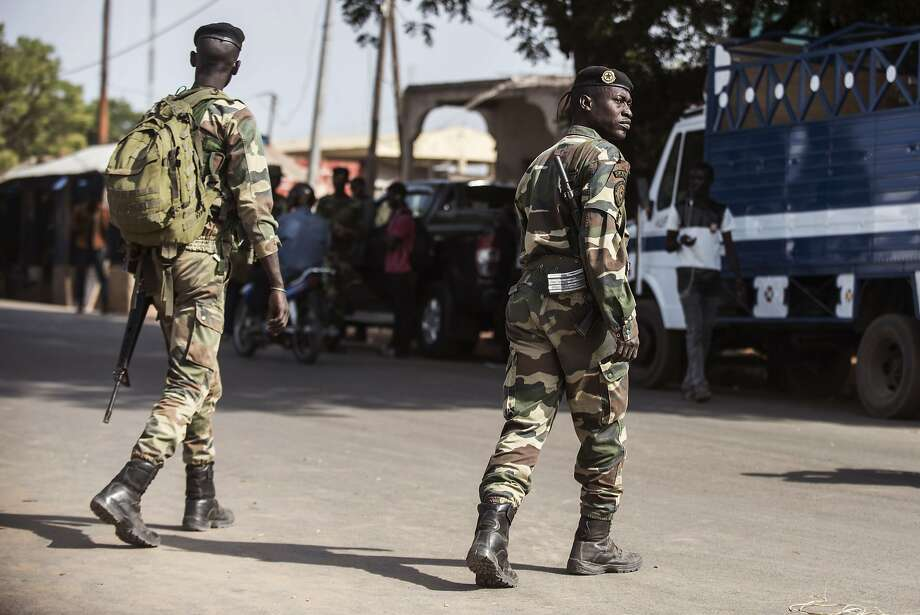 Soldiers patrol in Karang, Senegal, along the nation's border with Gambia. They are part of a regional security force that also includes troops from Ghana, Nigeria, Togo and Mali. Photo: Sylvain Cherkaoui, Associated Press