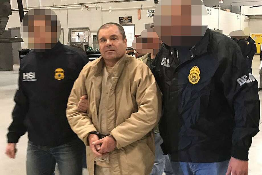 "TOPSHOT - This handout picture released by the Mexican Interior Ministry on January 19, 2017 shows Joaquin Guzman Loera aka ""El Chapo"" Guzman (C) escorted in Ciudad Juarez by the Mexican police as he is extradited to the United States.  Mexican drug baron Joaquin ""El Chapo"" Guzman, one of the world's most notorious criminals, was extradited to the United States on January 19, 2017 to face charges. - Pixelation of faces was done by the Mexican Interior Ministry / AFP PHOTO / INTERIOR MINISTRY OF MEXICO / HO /   RESTRICTED TO EDITORIAL USE-MANDATORY CREDIT ""AFP PHOTO/INTERIOR MINISTRY OF MEXICO"" NO MARKETING NO ADVERTISING CAMPAIGNS-DISTRIBUTED AS A SERVICE TO CLIENTS-XGTYHO/AFP/Getty Images Photo: HO, AFP/Getty Images"