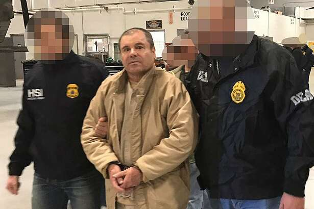 "TOPSHOT - This handout picture released by the Mexican Interior Ministry on January 19, 2017 shows Joaquin Guzman Loera aka ""El Chapo"" Guzman (C) escorted in Ciudad Juarez by the Mexican police as he is extradited to the United States.  Mexican drug baron Joaquin ""El Chapo"" Guzman, one of the world's most notorious criminals, was extradited to the United States on January 19, 2017 to face charges. - Pixelation of faces was done by the Mexican Interior Ministry / AFP PHOTO / INTERIOR MINISTRY OF MEXICO / HO /   RESTRICTED TO EDITORIAL USE-MANDATORY CREDIT ""AFP PHOTO/INTERIOR MINISTRY OF MEXICO"" NO MARKETING NO ADVERTISING CAMPAIGNS-DISTRIBUTED AS A SERVICE TO CLIENTS-XGTYHO/AFP/Getty Images"