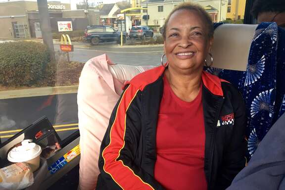 During a breakfast break in Birmingham, Alabama, Mary Smith sits on the Houston bus to the Women's March on Washington.