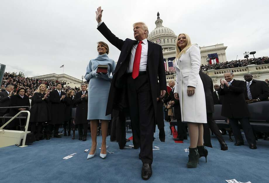 President Donald Trump waves after taking the oath of office as his wife Melania holds the Bible, and Tiffany Trump looks out to the crowd, Friday, Jan. 27, 2017 on Capitol Hill in Washington. (Jim Bourg/Pool Photo via AP) Photo: Jim Bourg, Associated Press