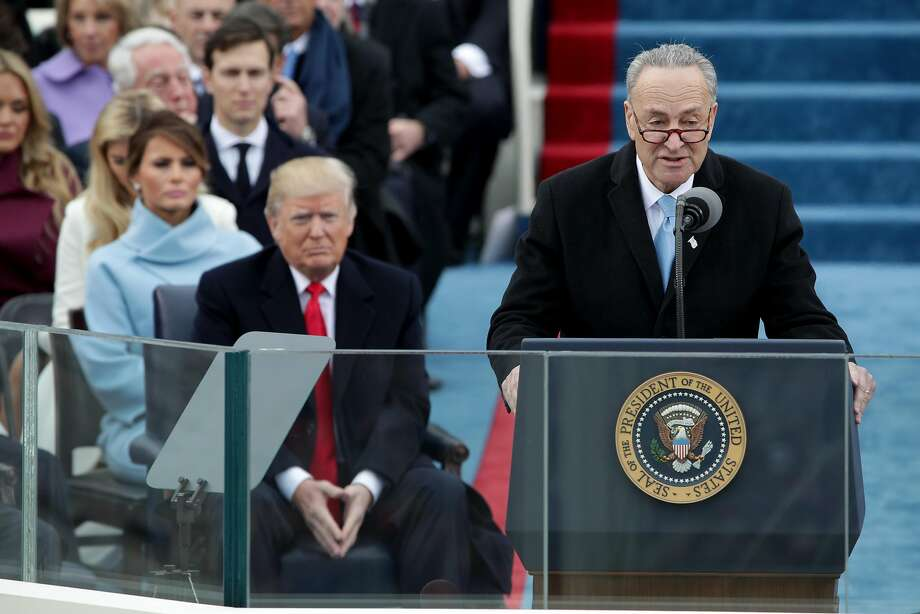 President-Elect Donald Trump listens as Sen. Charles Schumer (D-NY) speaks on the West Front of the U.S. Capitol on January 20, 2017 in Washington, DC. In today's inauguration ceremony Donald J. Trump becomes the 45th president of the United States. Photo: Alex Wong, Getty Images