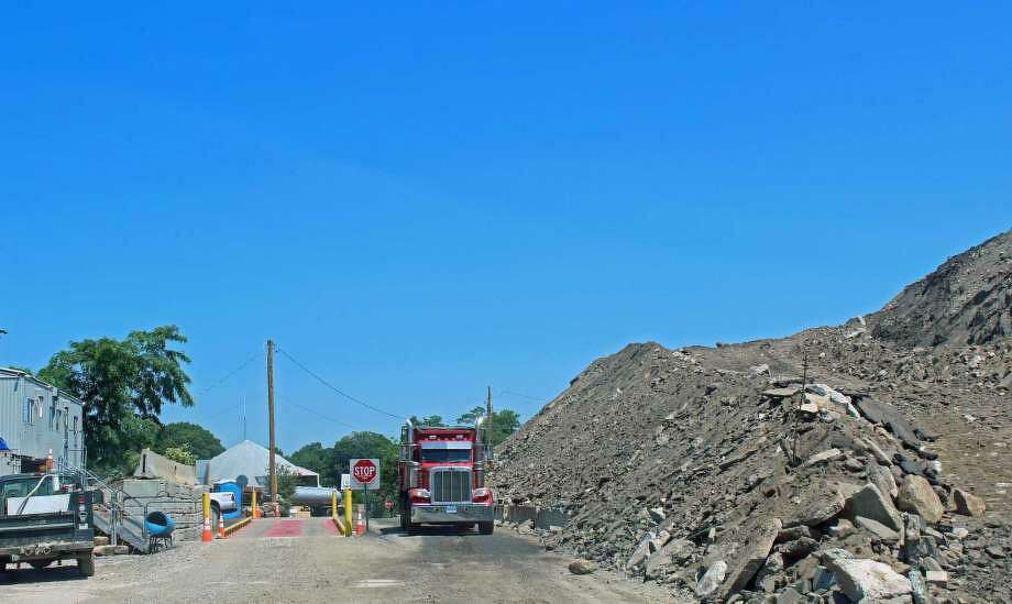 After small amounts of contaminants were found at the town's fill pile on Richard White Way, the site was shut down temporarily. Julian Enterprises, which ran the site until last December, was expected to be allowed to remove its equipment on Jan. 18. Photo: Genevieve Reilly / Hearst Connecticut Media / Fairfield Citizen