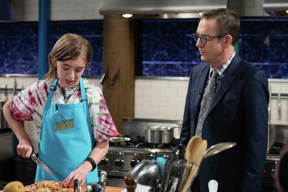 Fairfield eighth-grader CJ Vinas speaks with Chopped Junior Host Ted Allen during the Jan. 17 episode of the cooking competition show. Photo: Food Network / DECARLOPHOTOBLOG.COM