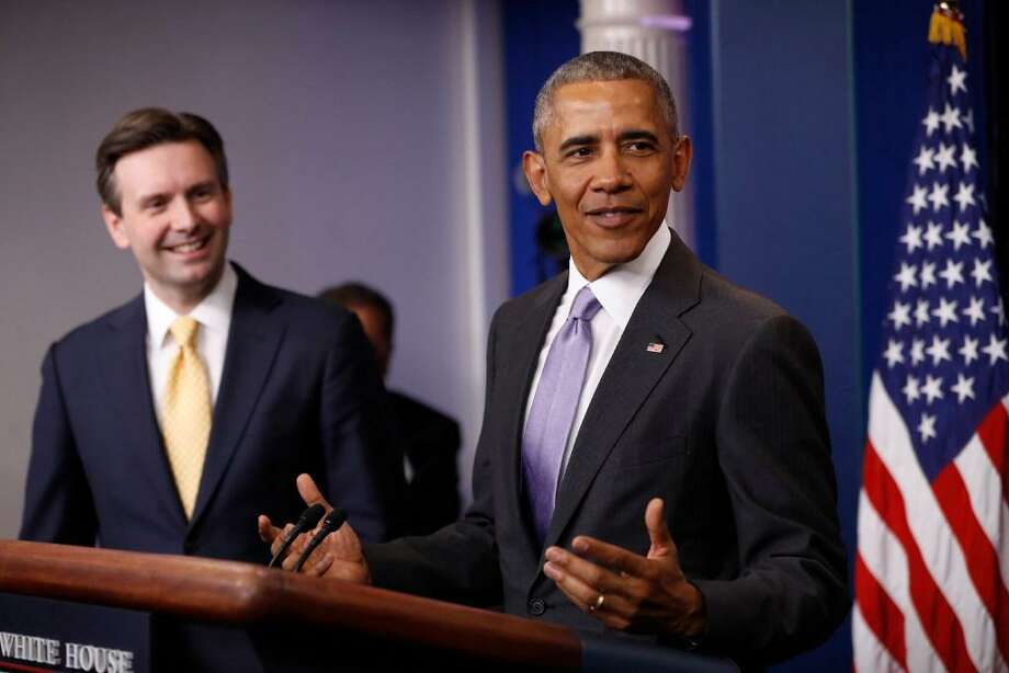 White House Press Secretary Josh Earnest listens as President Barack Obama speaks at his final daily press briefing, Tuesday, in the briefing room of the White House. Photo: AP Photo /Pablo Martinez Monsivais