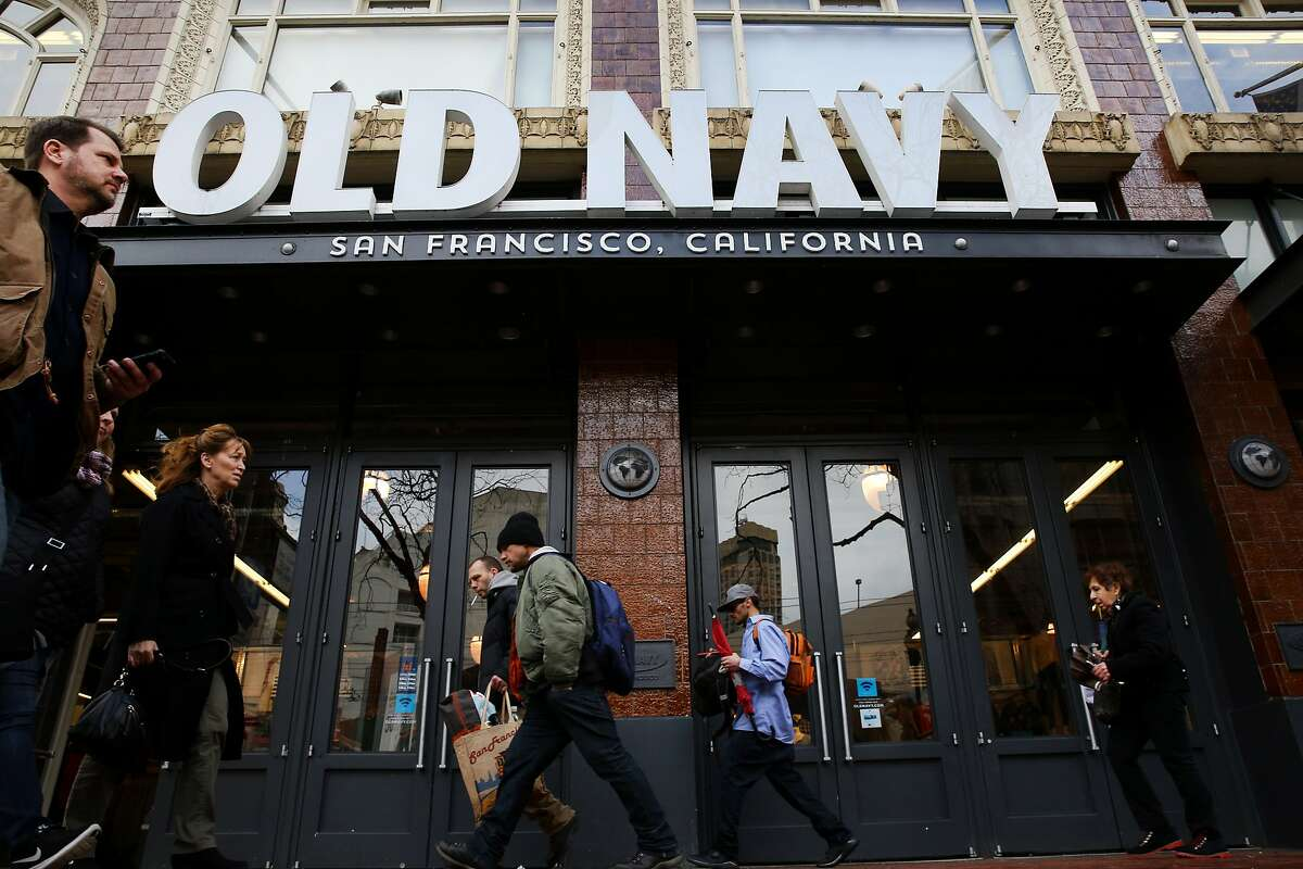 People walk past the Old Navy on Market Street on Friday, Jan. 20, 2017 in San Francisco, Calif. Congress is considering changes to the tax system that will make companies that import goods pay more taxes. Consumers might then face higher prices. Gap, which owns Old Navy, makes a lot of its clothing overseas.