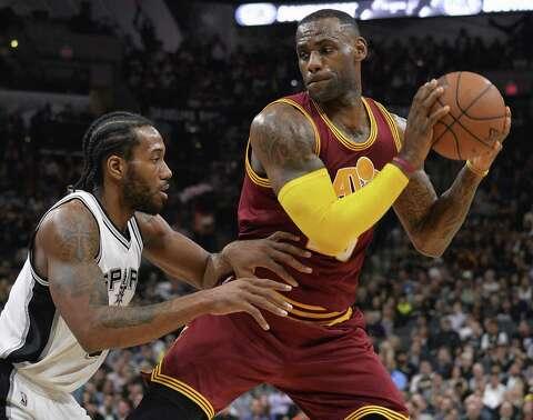 ec415e625f2c Cleveland Cavaliers forward LeBron James prepares to drive around the  Spurs  forward Kawhi Leonard during