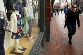 A woman walks past the Old Navy on Market Street on Friday, Jan. 20, 2017 in San Francisco, Calif. Congress is considering changes to the tax system that will make companies that import goods pay more taxes. Consumers might then face higher prices. Gap, which owns Old Navy, makes a lot of its clothing overseas.