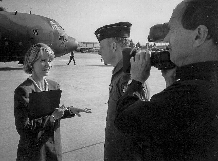 John Knoop filming Elizabeth Farnsworth on location, 1994 Photo: Jamie Kibben
