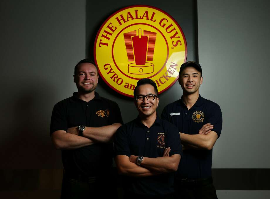 Rene Hjorth, director of operations (left); Binh Tran, franchise owner in S.F., the East Bay and Las Vegas; and Kent Li, the S.F. chain general manager at the new Halal Guys in S.F. Photo: Santiago Mejia, The Chronicle