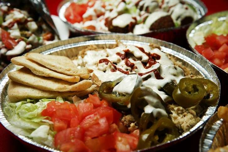 The chicken platter with jalape�os are seen at The Halal Guys located at 340 O'Farrell St., on Thursday, Jan. 19, 2017 in San Francisco, Calif.