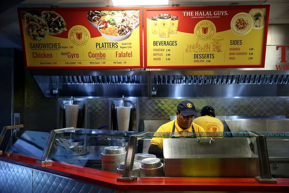 Pervaiz Bhatti makes a combo platter at The Halal Guys located in San Francisco, Calif. Photo: Santiago Mejia, The Chronicle