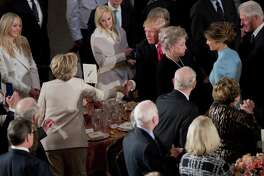 Newly sworn in President Donald Trump with his wife first lady Melania Trump, shakes hands with Hillary Clinton, as they arrive for the inaugural luncheon at the Statuary Hall in the Capitol, Friday, Jan. 20, 2017, in Washington. Trump became the 45th president of the United States. Others are former President Bill Clinton, right, and Trump's daughter Tiffany Trump, second from left.