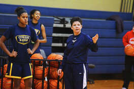 Cy Ranch Girls Basketball head coach Tresa Hornsby coaches her players up at practice Thursday. The Lady Mustangs have started district play on a tear, winning their first seven contests by more than a 23-point margin on average, and appear poised to do some real damage in the postseason.