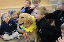 Sophie, a therapy dog with Therapy Dogs International, performs a demonstration with Trinity School kindergartners on Friday, Jan. 20, 2017, at Trinity School. James Durbin/Reporter-Telegram