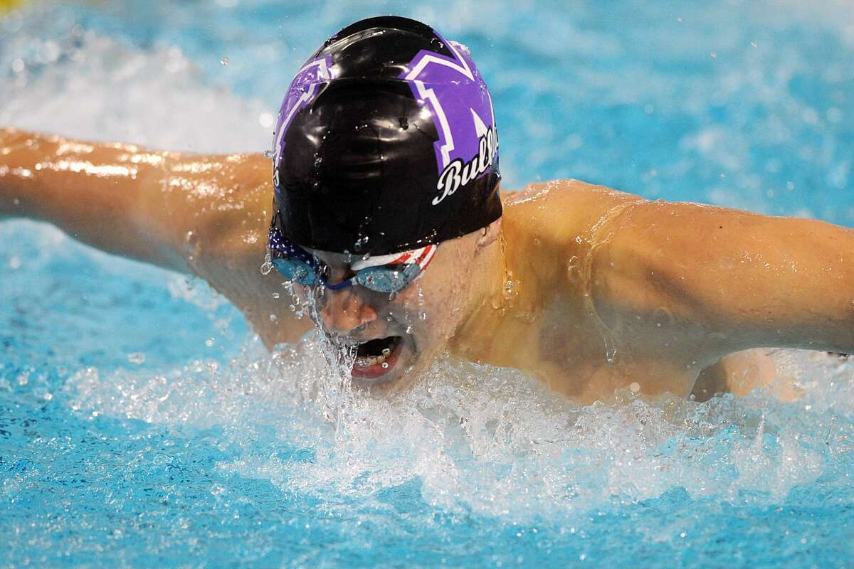 Midland High's Nathan Keller competes in the Men's 100 Yard Butterfly event during the District 2-6A swim meet Friday, Jan. 20, 2017, at COM Aquatics. James Durbin/Reporter-Telegram