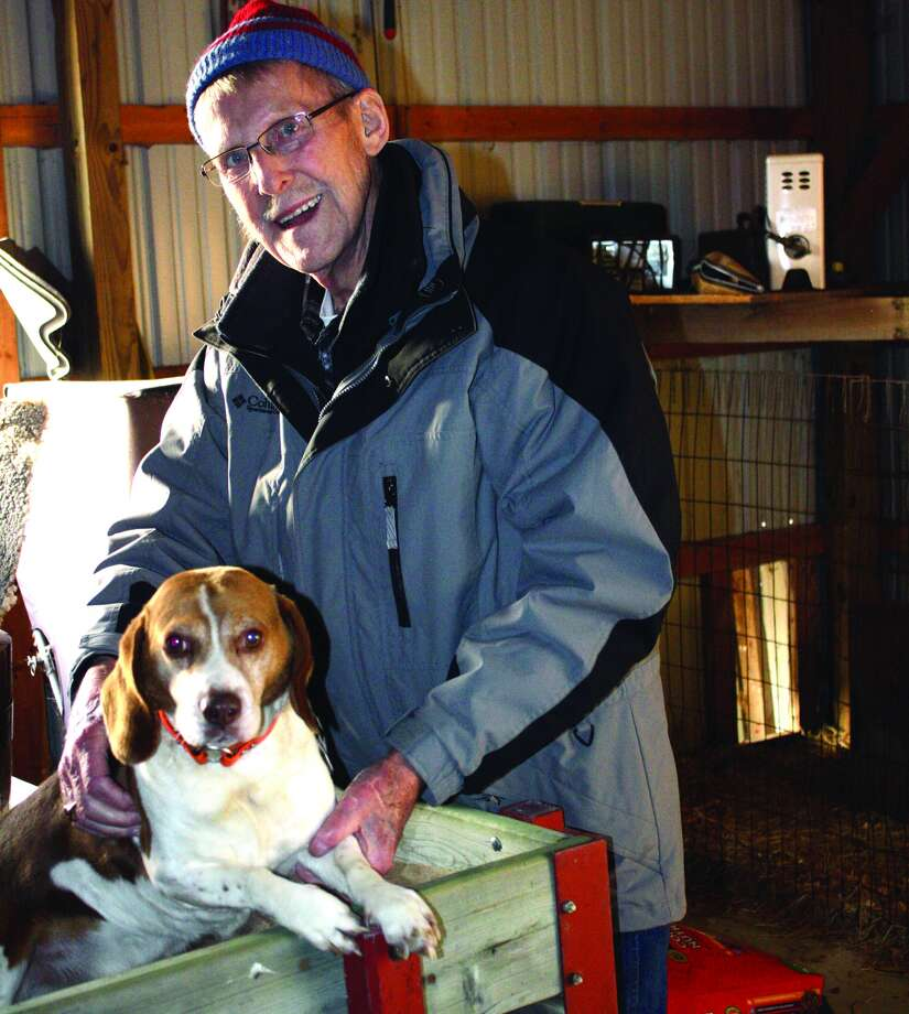 Richard Easton poses with his hunting dog. Photo: Rich Harp/For The Tribune