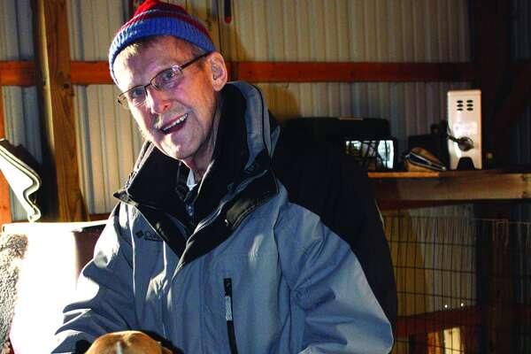 Richard Easton poses with his hunting dog.