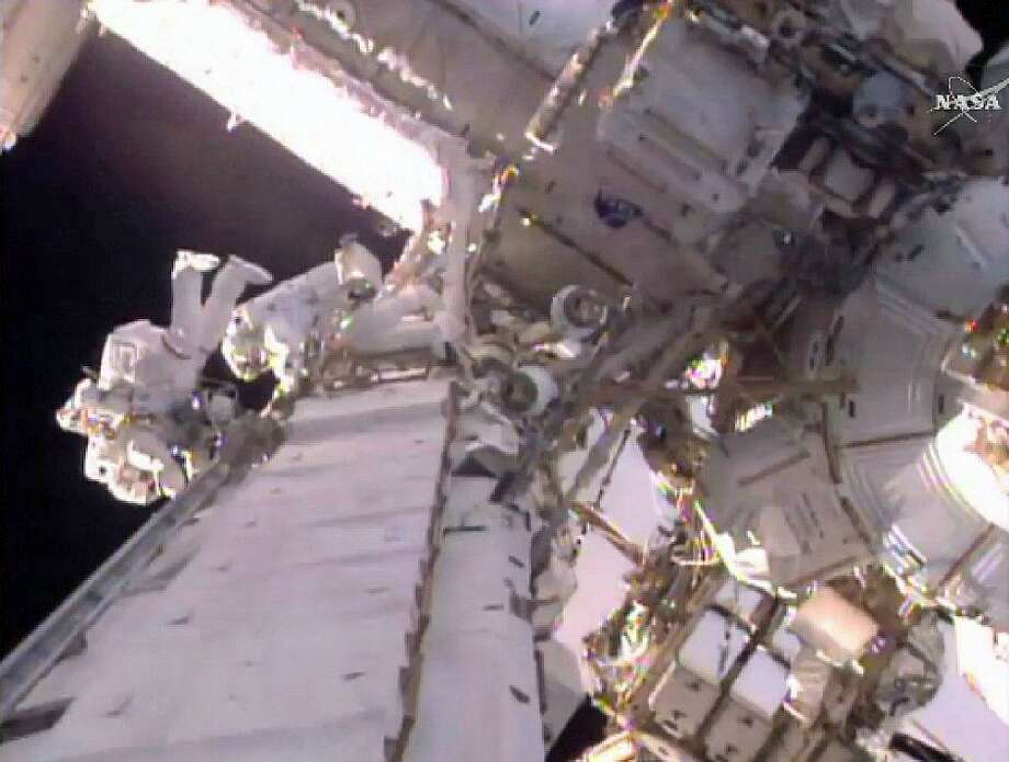 This still image taken from video provided by NASA shows U.S. astronaut Shane Kimbrough, left and French astronaut Thomas Pesquet during a space walk outside the International Space Station in mid-January. Photo: / NASA Via AP
