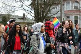 Students from Seattle's Garfield and Nova high schools march down East Jefferson Street to protest the inauguration of Donald J. Trump on Jan. 20, 2017. Student walk outs were held at several schools across Seattle and the country.