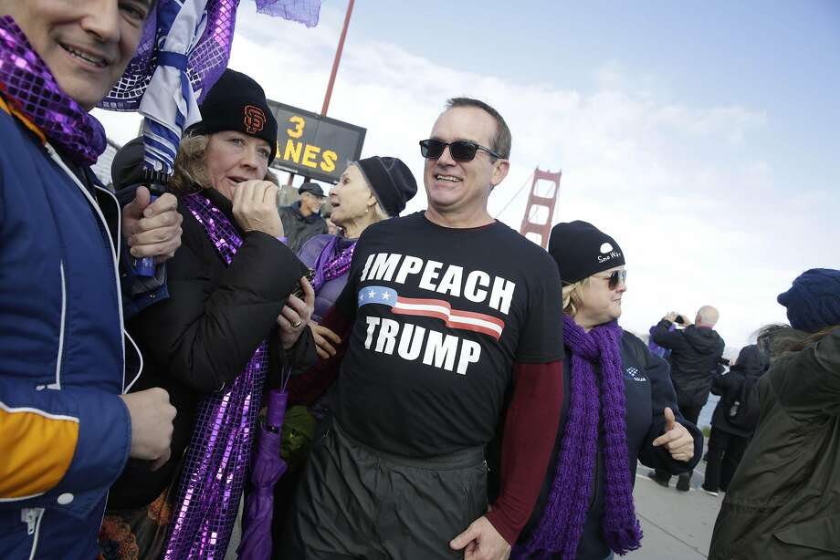 Pat Waters of San Francisco wears an Impeach Trump shirt during Bridge Together  on Friday, January 20,  2017 in San Francisco Calif. Photo: Lea Suzuki, The Chronicle
