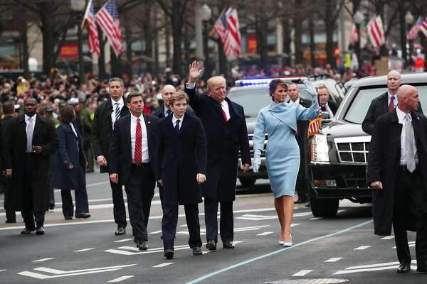 President Donald Trump and first lady Melania Trump walk briefly with their son Barron on the inauguration parade route in Washington, Jan. 20, 2017. (Doug Mills/The New York Times)