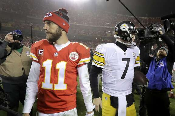 Kansas City Chiefs quarterback Alex Smith (11) walks off the field after talking with Pittsburgh Steelers quarterback Ben Roethlisberger (7) at the end of an NFL divisional playoff football game Sunday, Jan. 15, 2017, in Kansas City, Mo. The Steelers won 18-16. (AP Photo/Charlie Riedel)