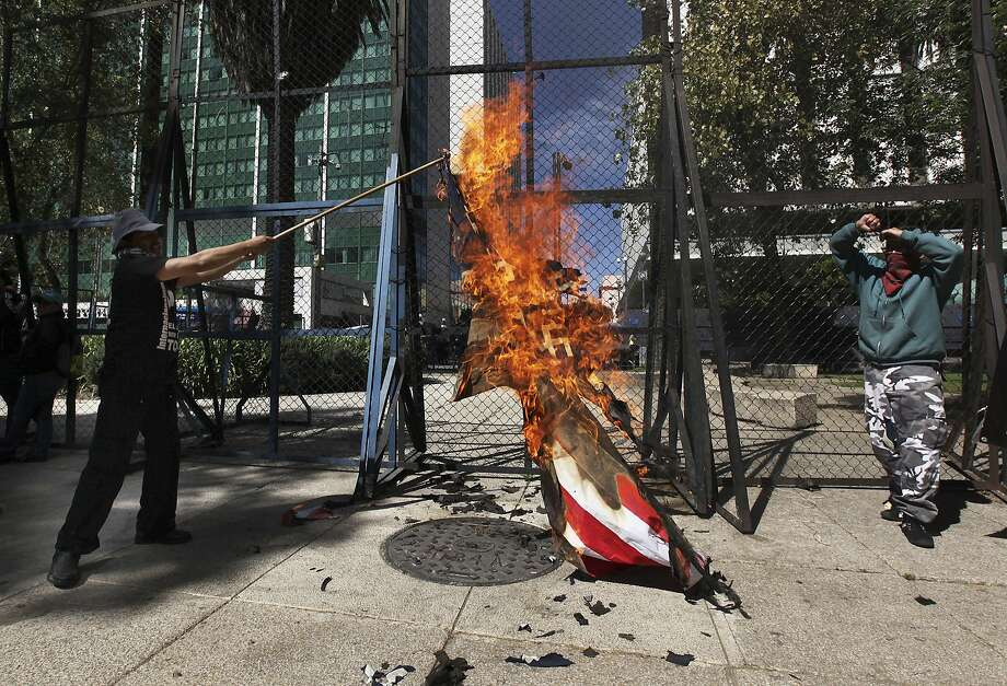 Hundreds protest Trump at US Embassy in Mexico City San