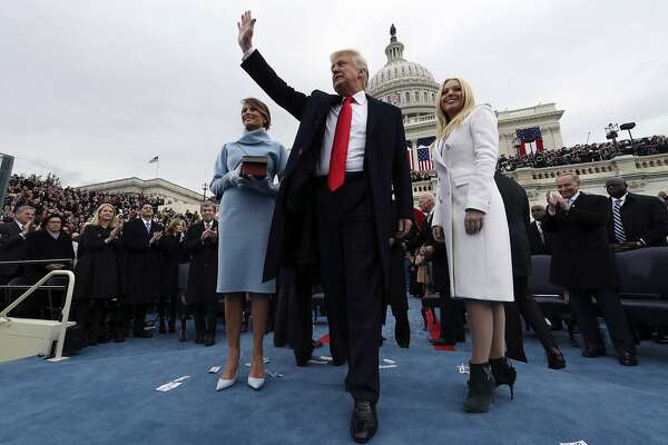 WASHINGTON, DC - JANUARY 20:  U.S. President Donald Trump acknowledges the audience after taking the oath of office as his wife Melania (L) and daughter Tiffany watch during inauguration ceremonies swearing in Trump as the 45th president of the United States on the West front of the U.S. Capitol in Washington, DC. January 20, 2017. (Photo by Jim Bourg - Pool/Getty Images) *** BESTPIX ***